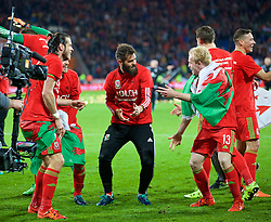 CARDIFF, WALES - Tuesday, October 13, 2015: Wales' Joe Ledley performs his Bosnia dance with Gareth Bale and Jonathan Williams as the team celebrate qualifying for the finals after the 2-0 victory over Andorra during the UEFA Euro 2016 qualifying Group B match at the Cardiff City Stadium. (Pic by Barry Coombs/Propaganda)