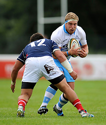 Alex Allan (Glasgow Warriors) takes on the London Scottish defence - Photo mandatory by-line: Patrick Khachfe/JMP - Mobile: 07966 386802 30/08/2014 - SPORT - RUGBY UNION - London - Richmond Athletic Ground - London Scottish v Glasgow Warriors - Pre-Season Friendly