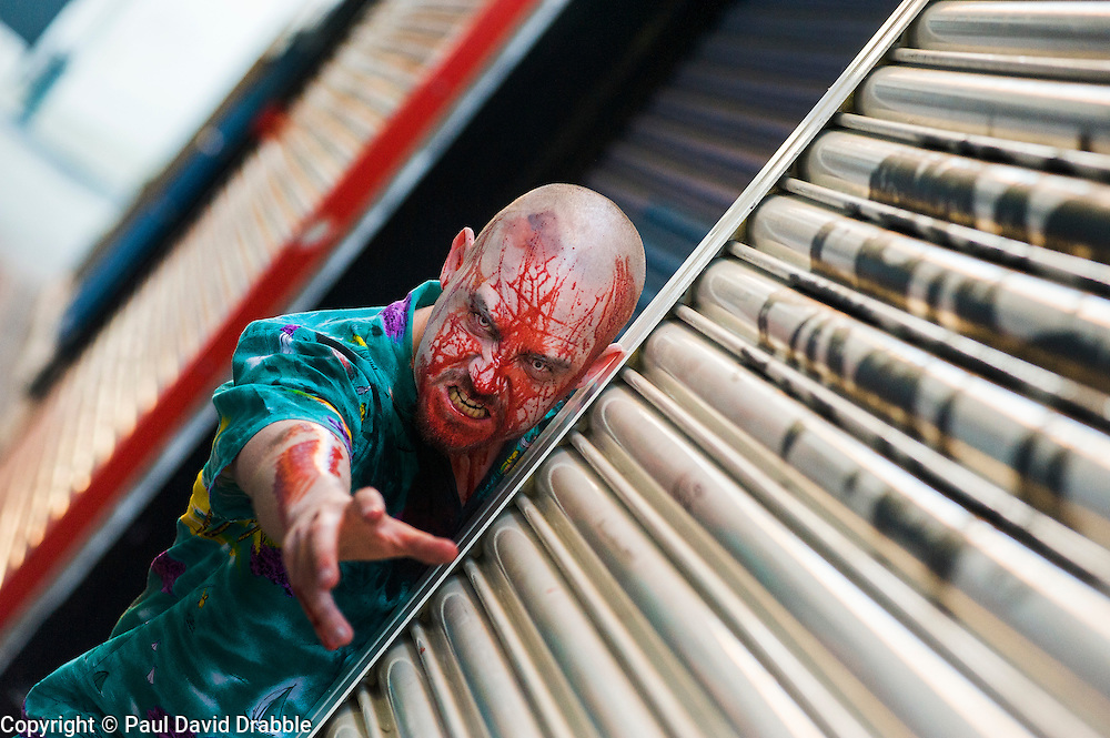 Slingshots Top Zombie Noel Davies-Atack on Chapel Walk Sheffield on Tuesday evening ahead of the game 2.8 Hours Later which reaches the city in August <br /> <br /> 30 June 2015<br />  Image &copy; Paul David Drabble <br />  www.pauldaviddrabble.co.uk
