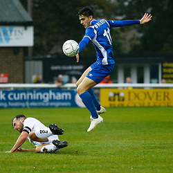 Salford's midfielder Tom Walker leaps over Dovers midfielder Mitch Brundle during the National League match between Dover Athletic FC and Salford City FC at Crabble Stadium, Kent on 06 October 2018. Photo by Matt Bristow.