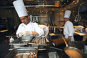 Unidentified junior chefs work in the kitchen of Beige Alain Ducasse Tokyo in the Ginza district of Tokyo, Japan. ROB GILHOOLY