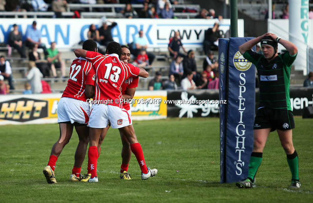 Poverty Bay players Paulo Tikomainaivalu and John Stewart celebrate with Ratu Vosaki after his second try during the Heartland Championship Lochore Cup Final between, South Canterbury v Poverty Bay at Alpine Energy Stadium, Timaru, South Canterbury. Saturday 8 October 2011. Photo : Joseph Johnson/photosport.co.nz