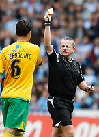 Photo: Richard Lane/Richard Lane Photography. Coventry City v Norwich City. Coca-Cola Championship. 09/08/2008. Referee, C. Taylor books Norwich's Dejan Stefanovic.