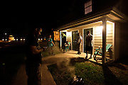 "Roommates and creative partners Joshua Giha, right, James Klynn, and Jeremy Evans, left, host a party at their home in Naples, Fla. The friends later formed Freedom Hall, a collective of artists who come together to create music. ""Hip hop is a number of different things. It's a culture. Hip hop is self expression. it came from a group of people who didn't have anybody to speak for them, so they started their own."""
