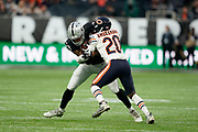 Prince Amukamara (DB) of the Chicago Bears tackles DeAndre Washington (RB) of the Oakland Raiders during the International Series match between Oakland Raiders and Chicago Bears at Tottenham Hotspur Stadium, London, United Kingdom on 6 October 2019.