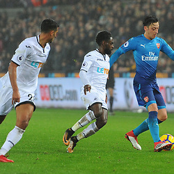 Mesut Özil of Arsenal is challenged by Nathan Dyer of Swansea City during Swansea City vs Arsenal, Premier League, 30.01.18 (c) Harriet Lander | SportPix.org.uk