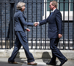 © Licensed to London News Pictures. 26/07/2016. London, UK. British prime minister THERESA MAY greets Taoiseach ENDA KENNY outside Number 10 Downing Street. The pair are expected to discuss impact of Britain's recent vote for Brexit. Photo credit: Ben Cawthra/LNP