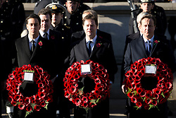 © London News Pictures. 11/11/2012. London, UK. Front L to R  Ed Miliband (Labour Party Leader), Nick Clegg (Deputy Prime Minister) and David CAmeron (British Prime Minister) holding wreaths during a Remembrance Day Ceremony at the Cenotaph on November 11, 2012 in London, United Kingdom. Photo Credit: Ben Cawthra/LNP