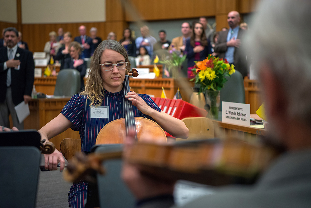 em020618b/jnorth/Lisa Donald and other members of the New Mexico Philharmonic perform the National Anthem at the start of the floor session in the House Chambers in Santa Fe Tuesday, February 6, 2018. (Eddie Moore/Albuquerque Journal)