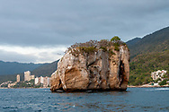 Los Arcos National Park and Marine Preserve on the Bay of Banderas,  near Puerto Vallarta, Mexico. The rocky islets attract several species of birds, many of which come to roost here for the night as seen on this evening.