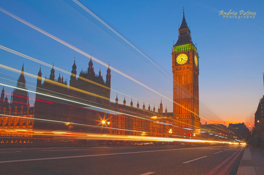 Traffic blur in front of Big Ben at twilight
