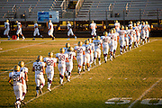 23 SEPTEMBER 2011 - SCOTTSDALE, AZ: Notre Dame takes the field to warm up at Desert Mountain High School in Scottsdale. Desert Mountain played Notre Dame in Desert Mountain's homecoming high school football game.     PHOTO BY JACK KURTZ