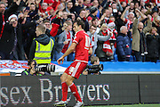 Middlesbrough FC striker Christian Stuani celebrates the third goal during the Sky Bet Championship match between Brighton and Hove Albion and Middlesbrough at the American Express Community Stadium, Brighton and Hove, England on 19 December 2015. Photo by Phil Duncan.