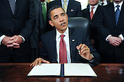 U.S. President Barack Obama speaks to the press prior to signing the third of four executive orders to close the Guantanamo Bay Detention facility, on his desk in the Oval Office at the White House in Washington, DC, USA on 22 January 2009. Vice President Joseph Biden (L) and a group of retired military officers attended the ceremony.