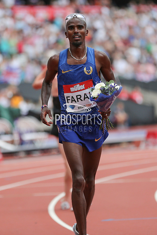 Mo Farah GBR celebrates winning the 5000m with flowers during the Muller Anniversary Games at the Stadium, Queen Elizabeth Olympic Park, London, United Kingdom on 23 July 2016. Photo by Phil Duncan.