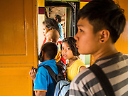 20 MARCH 2015 - PRACHINBURI, PRACHINBURI, THAILAND:  People line up to get off a third class train in the Chachoengsao station. The State Railways of Thailand (SRT), established in 1890, operates 4,043 kilometers of meter gauge track that reaches most parts of Thailand. Much of the track and many of the trains are poorly maintained and trains frequently run late. Accidents and mishaps are also commonplace. Successive governments, including the current military government, have promised to upgrade rail services. The military government has signed contracts with China to upgrade rail lines and bring high speed rail to Thailand. Japan has also expressed an interest in working on the Thai train system. Third class train travel is very inexpensive. Many lines are free for Thai citizens and even lines that aren't free are only a few Baht. Many third class tickets are under the equivalent of a dollar. Third class cars are not air-conditioned.  PHOTO BY JACK KURTZ