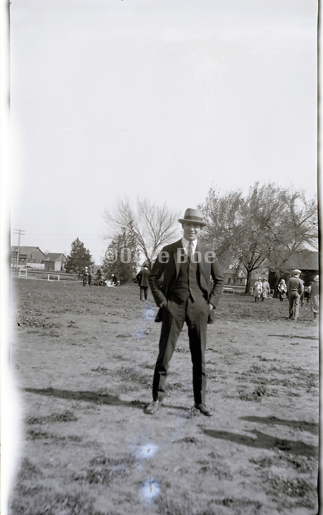 young man in suit standing in back yard field 1920s Missouri USA