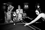 A group of naked pub goers playing pool in a pub, UK 2004