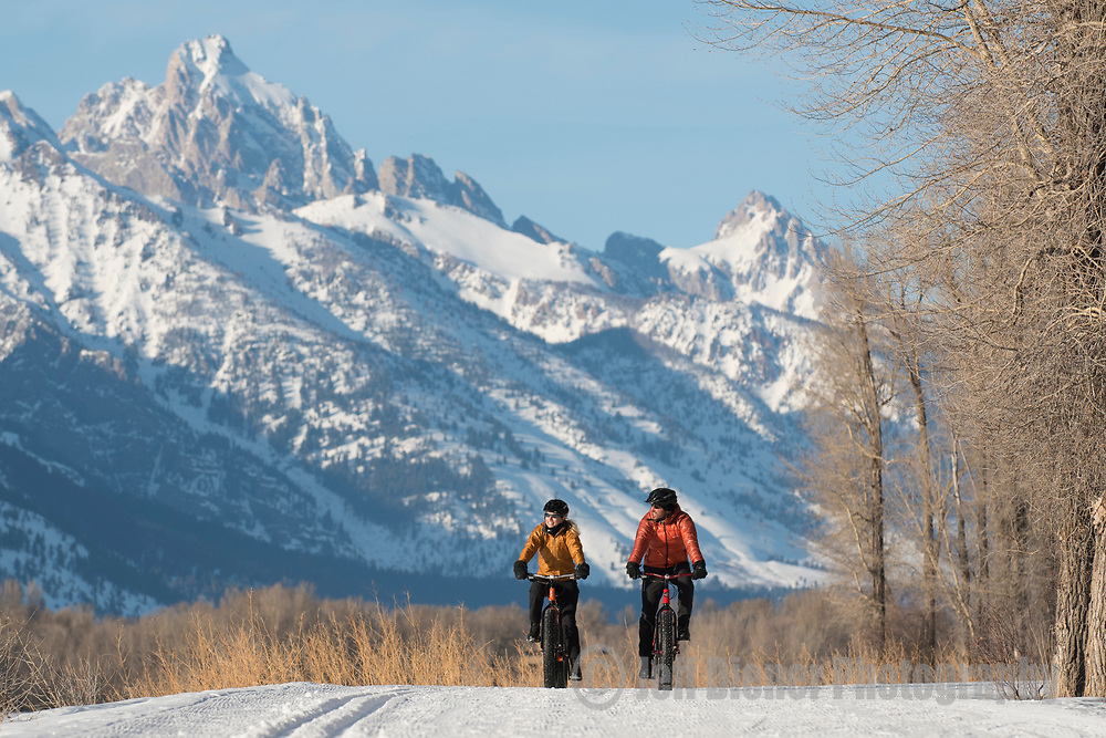 A young couple rides fat bikes in Jackson Hole, Wyoming.