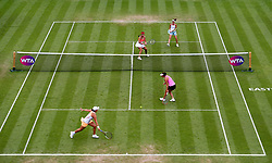 A general view of Chinese Taipei's Yung-jan Chan (top left) and Switzerland's Martina Hingis (top right) in action against Australia's Ashleigh Barty (bottom left) and Casey Dellacqua (bottom right) in the Women's Doubles Final during day nine of the AEGON International at Devonshire Park, Eastbourne.