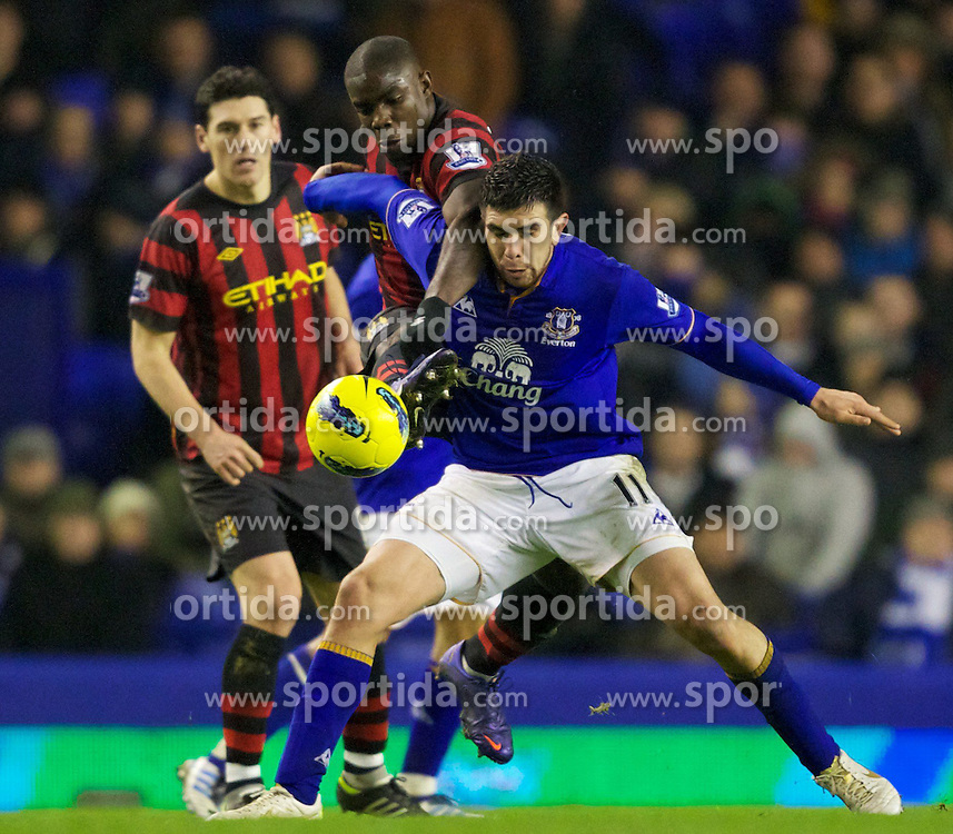 31.01.2012, Goodison Park Stadion, Liverpool, ENG, PL, FC Everton vs Manchester City, 22. Spieltag, im Bild Manchester City's Micah Richards in action against Everton's Denis Stracqualursi during the football match of English premier league, 22th round, between FC Everton and Manchester City at Goodison Park Stadium, Liverpool, United Kingdom on 2012/01/31. EXPA Pictures © 2012, PhotoCredit: EXPA/ Propagandaphoto/ Vegard Grott..***** ATTENTION - OUT OF ENG, GBR, UK *****