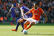 Liam Feeney of Blackpool has his shorts tugged by Brandon Haunstrup of Portsmouth during the EFL Sky Bet League 1 match between Blackpool and Portsmouth at Bloomfield Road, Blackpool, England on 31 August 2019.