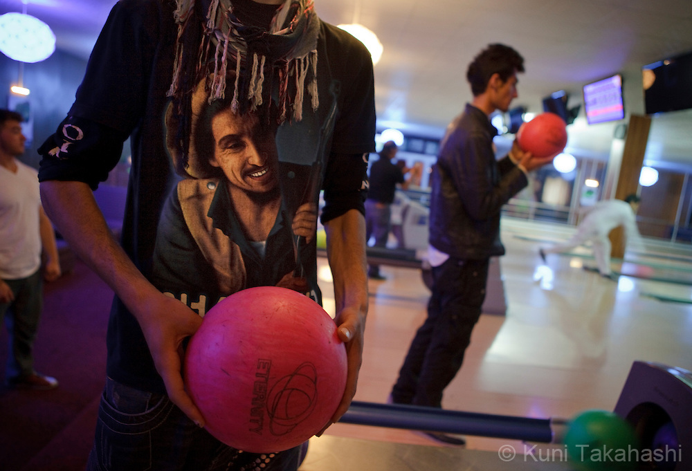 Young Afghans play bowling at a bowling alley, The Strikers, in Kabul on May 4, 2012. The country's first bowling alley was opened in October 2011 by Afghan woman Meena Rahmani to give youths an outlet for entertainment, something that is rare in this war-stricken country. .(Photo by Kuni Takahashi)