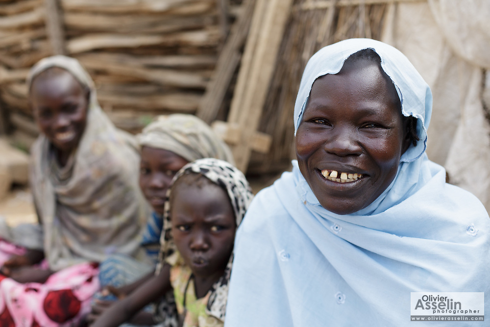 Fatime Abdramane, 30, sits at home with her daughters (from left to right) Zeinaba, 10, Khadija, 8, and Nafaye, 6 in the village of Game, Guera province, Chad on Tuesday October 16, 2012.