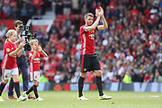 Manchester United 08 XI Michael Carrick says thank you and applauds the fans during the Michael Carrick Testimonial Match between Manchester United 2008 XI and Michael Carrick All-Star XI at Old Trafford, Manchester, England on 4 June 2017. Photo by Phil Duncan.