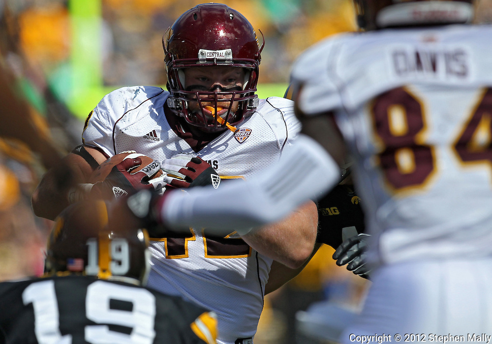 September 22 2012: Central Michigan Chippewas fullback Tyler Lombardo (42) on a run during the first half of the NCAA football game between the Central Michigan Chippewas and the Iowa Hawkeyes at Kinnick Stadium in Iowa City, Iowa on Saturday September 22, 2012. Central Michigan defeated Iowa 32-31.