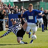 Irvine Meadow V Pollok, Meadow Park, Irvine. Pollok's Shaun Dillon (left) tries to stop Irvine's Christopher Strain.