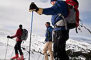 Skiers, Neal Mendal, Celin Serbo and DJ Nechrony, prepare themselves to ski the  backcountry bowls at Loveland Pass, Colorado.