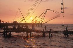 Sunset and Chinese fishing nets at Cochin; Kerala; India,