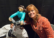 Garden City, New York, U.S. - June 14, 2014 - Actress CATHERINE MARY STEWART (Weekend at Bernie's) poses with a balloon girl riding a motorcycle at Eternal Con, the annual Pop Culture Expo, with costumes, Comic Books, Collectibles, Gaming, Sci-Fi, Cosplay, Horror, and held at the Cradle of Aviation Museum on Long Island. Stewart rides a motorcycle in the zombie movie Night of the Comet)
