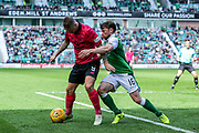 Lewis Stevenson (#16) of Hibernian challenges Leigh Griffiths (#9) of Celtic for the ball during the Ladbrokes Scottish Premiership match between Hibernian and Celtic at Easter Road, Edinburgh, Scotland on 21 April 2018. Picture by Craig Doyle.