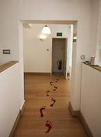 Footprints leading towards open door