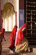 Sari clad women entering a temple in Pushkar, Rajasthan, India