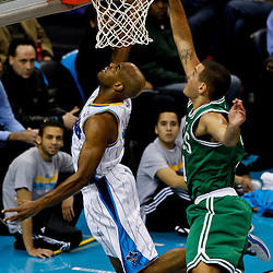 December 28, 2011; New Orleans, LA, USA; New Orleans Hornets point guard Jarrett Jack (2) shoots over Boston Celtics small forward Sasha Pavlovic (11) during the first quarter of a game at the New Orleans Arena.   Mandatory Credit: Derick E. Hingle-US PRESSWIRE