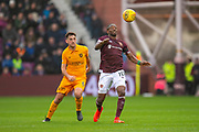 Arnaud Djoum (#10) of Heart of Midlothian controls the ball ahead of Shaun Byrne (#6) of Livingston FC during the 4th round of the William Hill Scottish Cup match between Heart of Midlothian and Livingston at Tynecastle Stadium, Edinburgh, Scotland on 20 January 2019.