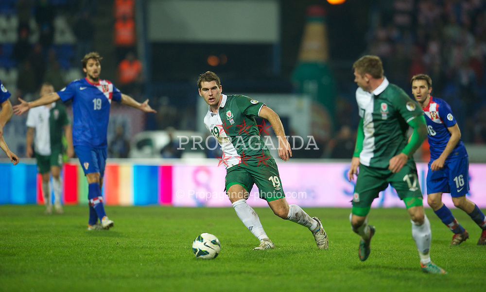 OSIJEK, CROATIA - Tuesday, October 16, 2012: Wales' Sam Vokes in action against Croatia during the Brazil 2014 FIFA World Cup Qualifying Group A match at the Stadion Gradski Vrt. (Pic by David Rawcliffe/Propaganda)
