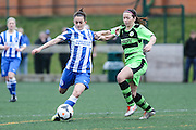 Brighton's Kate Natkiel holds off Forest Green's Sophie Okey during the FA Women's Premier League match between Forest Green Rovers Ladies and Brighton Ladies at the Hartpury College, United Kingdom on 24 January 2016. Photo by Shane Healey.