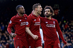 LONDON, ENGLAND - Sunday, March 17, 2019: Liverpool's captain James Milner (C) celebrates scoring the second goal from a penalty kick with team-mates Georginio Wijnaldum (L) and Mohamed Salah (R) during the FA Premier League match between Fulham FC and Liverpool FC at Craven Cottage. (Pic by David Rawcliffe/Propaganda)