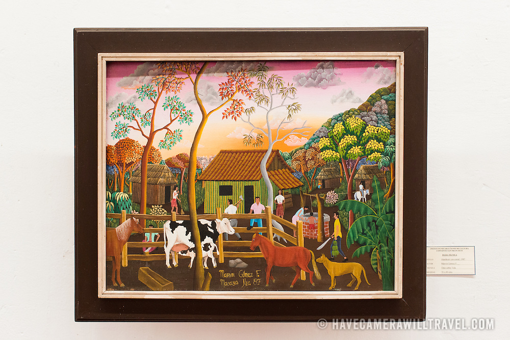 The painting is titled Atardecer con corral, 1987, and was painted by Marvin Gomez F. The The Centro Cultural Convento San Francisco, located just a couple of blocks from Parque Central in Granada, is dedicated to the history of the region.