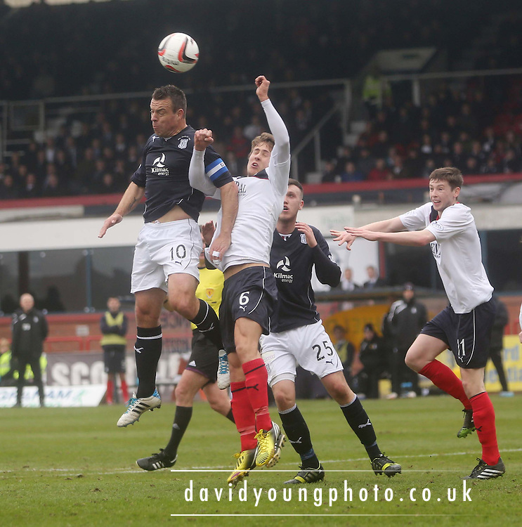 Gavin Rae outjumps Will Vaulks - Dundee  v Falkirk - SPFL Championship at Dens Park<br /> <br />  - &copy; David Young - www.davidyoungphoto.co.uk - email: davidyoungphoto@gmail.com