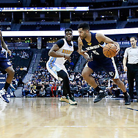 01 February 2016: Memphis Grizzlies guard Andrew Harrison (5) drives past Denver Nuggets guard Emmanuel Mudiay (0) during the Memphis Grizzlies 119-99 victory over the Denver Nuggets, at the Pepsi Center, Denver, Colorado, USA.