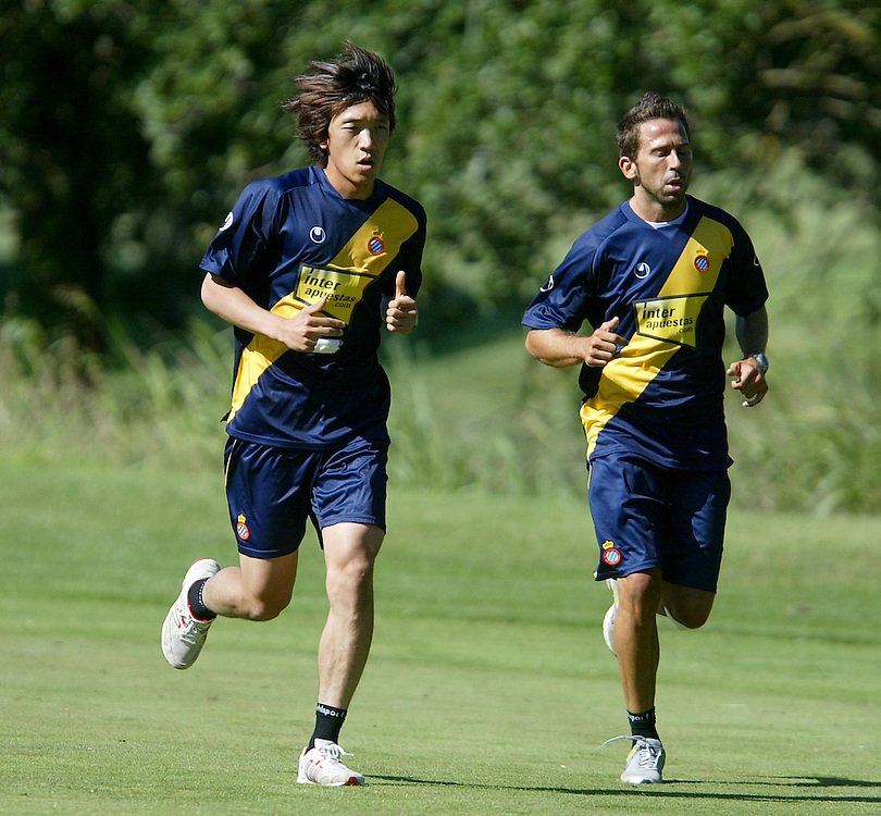 July 18th. 2009. Shunsuke Nakamura, new player of the R.C.D. Espanyol of Barcelona, training in the preseason of his team in Peralada. Raul Tamudo on his side.