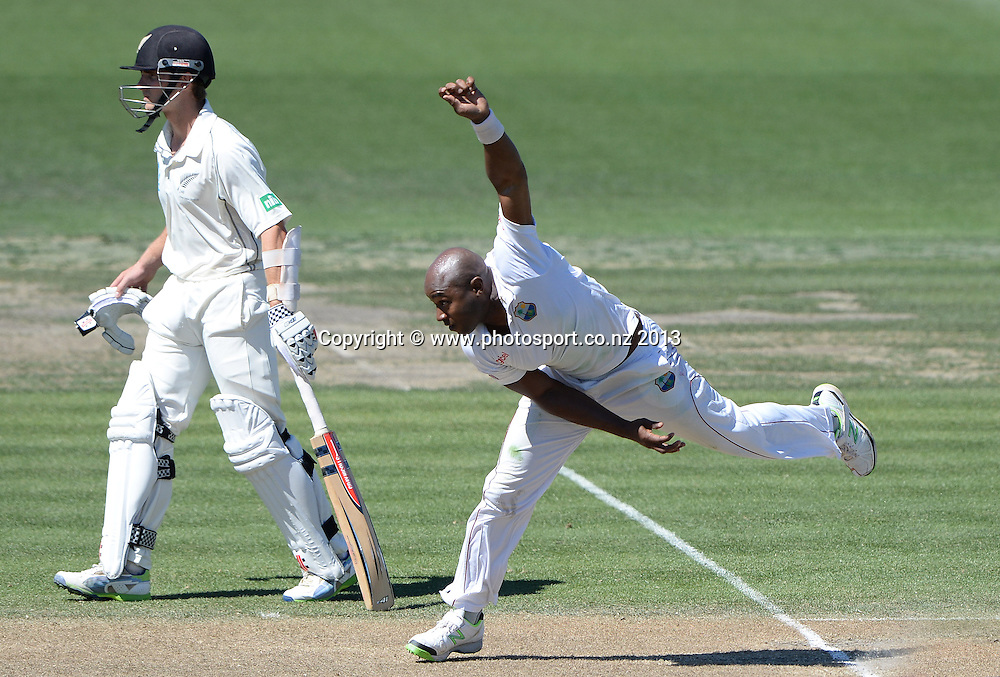 Tino Best bowling on Day 2 of the 3rd cricket test match of the ANZ Test Series. New Zealand Black Caps v West Indies at Seddon Park in Hamilton. Friday 20 December 2013. Photo: Andrew Cornaga / www.Photosport.co.nz