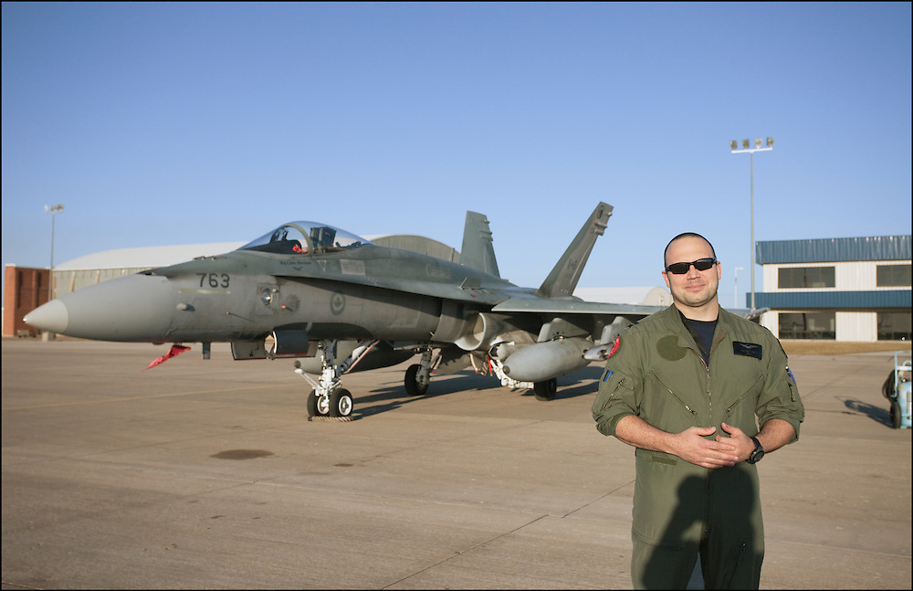 Canadian fighter pilot standing in front of his CF-18 at the Airport in Salina, Kansas.