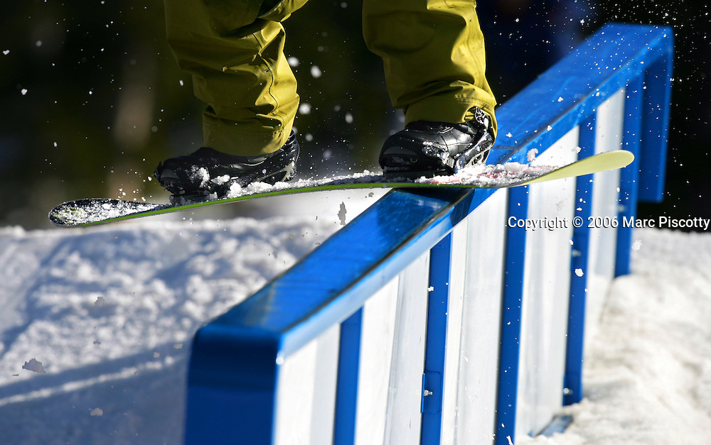 A snowboarder board slides a rail at Echo Mountain Park near Evergreen on Sunday April 9, 2006. Rails at the park come in a variety of shapes, sizes and skill levels. Echo Mountain Park is Colorado's first terrain-park only ski and snowboard area and features numerous rails, obstacles and jumps on the site of the former Squaw Pass Ski Area in the Arapaho National Forest near Mount Evans. The area opened recently and is hoping to attract a younger crowd with cheaper tickets, music, contests and a shorter and easier drive from Denver..(MARC PISCOTTY/ © 2006)