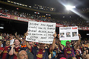 A fan holds up a sign (R) depicting the good (Messi), the bad (Mourinho) and the ugly (Ronaldo). Barcelona v Real Madrid, Supercopa first leg, Camp Nou, Barcelona, 23rd August 2012...Credit - Eoin Mundow/Cleva Media.